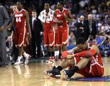 Ohio State forward Jared Sullinger (0) sits on the court after they lost to Kansas 64-62 in an NCAA Final Four semifinal college basketball tournament game Saturday, March 31, 2012, in New Orleans. (AP Photo/David J. Phillip) 0