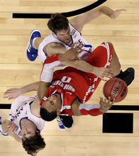 Ohio State forward Jared Sullinger (0) is blocked from the basket by Kansas center Jeff Withey (5), top, and guard Conner Teahan (2), bottom left, during the first half of an NCAA Final Four semifinal college basketball tournament game Saturday, March 31, 2012, in New Orleans. (AP Photo/Mark Humphrey)
