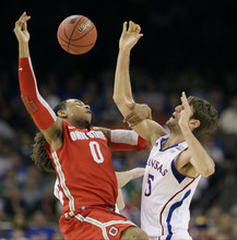 Ohio State's Jared Sullinger (0) fights for a loose ball with Kansas' Jeff Withey, right, during the first half of an NCAA Final Four semifinal college basketball tournament game Saturday, March 31, 2012, in New Orleans. (AP Photo/Mark Humphrey)