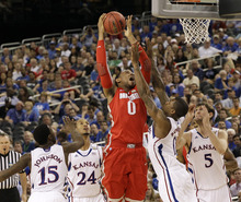 Ohio State's Jared Sullinger (0) shoots over Kansas' Elijah Johnson (15), Travis Releford (24), Thomas Robinson (0) and Jeff Withey (5) during the second half of an NCAA Final Four semifinal college basketball tournament game Saturday, March 31, 2012, in New Orleans. (AP Photo/Mark Humphrey)