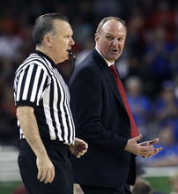 Ohio State head coach Thad Matta calls out to an official during the second half of an NCAA Final Four semifinal college basketball tournament game against Kansas Saturday, March 31, 2012, in New Orleans. (AP Photo/David J. Phillip)