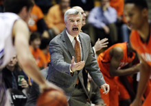 FILE - In this Jan. 4, 2012 file photo, Illinois head coach Bruce Weber yells to his team during the first half of an NCAA college basketball game against Northwestern in Evanston, Ill. A person familiar with the situation says Weber has been hired by Kansas State to replace men's basketball coach Frank Martin, who left for South Carolina.(AP Photo/Nam Y. Huh, File)