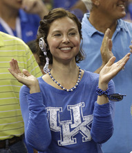 Actress Ashley Judd cheers before an NCAA Final Four semifinal college basketball tournament game between Kentucky and Louisville Saturday, March 31, 2012, in New Orleans. (AP Photo/David J. Phillip)
