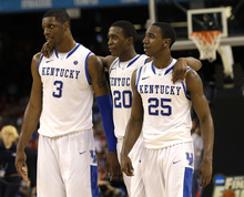 Kentucky forward Terrence Jones (3), guard Doron Lamb (20) and guard Marquis Teague (25) celebrate during the second half of an NCAA Final Four semifinal college basketball tournament game against Louisville Saturday, March 31, 2012, in New Orleans.  Kentucky won 69-61. (AP Photo/David J. Phillip)