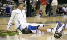 Kentucky's Anthony Davis stretches before an NCAA Final Four semifinal college basketball tournament game against Louisville Saturday, March 31, 2012, in New Orleans. (AP Photo/Mark Humphrey)