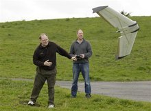 In this March, 28, 2012, photo, Mark Harrison, left, and Andreas Oesterer, right, watch as a Ritewing Zephyr II drone lifts off at a waterfront park in Berkeley, Calif. Interest in the domestic use of drones is surging among public agencies and private citizens alike, including a thriving subculture of amateur hobbyists, even as the prospect of countless tiny but powerful eyes circling in the skies raises serious privacy concerns. (AP Photo/Eric Risberg)