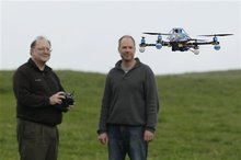 In this March, 28, 2012, photo, Mark Harrison, left, pilots an Arcti Copter 5 drone as Andreas Oesterer, right, watches at a waterfront park in Berkeley, Calif. Interest in the domestic use of drones is surging among public agencies and private citizens alike, including a thriving subculture of amateur hobbyists, even as the prospect of countless tiny but powerful eyes circling in the skies raises serious privacy concerns. (AP Photo/Eric Risberg)