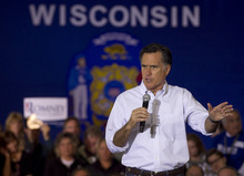 Republican presidential candidate, former Massachusetts Gov. Mitt Romney, campaigns in Muskego, Wis., Saturday, March 31, 2012. (AP Photo/Steven Senne)