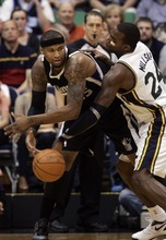 Kim Raff | The Salt Lake Tribune Jazz player Paul Millsap creates a turnover as Kings player Demarcus Cousins tries to hang onto the ball during a game at EnergySolutions Arena in Salt Lake City, Utah on March 30, 2012.