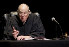 FILE - In this Jan. 31, 2011, file photo U.S. Supreme Court Justice Anthony Kennedy presides over a representation of
