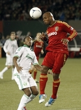 Real Salt Lake defender Jamison Olave, right, heads the ball away from Portland Timbers midfielder Franck Songo'o during the second half of their MLS soccer game  in Portland, Ore., Saturday, March 31, 2012.  Real Salt Lake won 3-2.(AP Photo/Don Ryan)