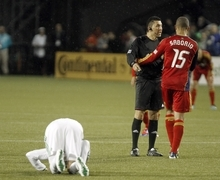 The referee admonishes Real Salt Lake  forward Alvaro Saborio, right, for fouling Portland Timbers defender Eric Brunner during the first half of their MLS soccer game  in Portland, Ore., Saturday, March 31, 2012.(AP Photo/Don Ryan)