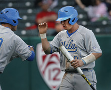 Scott Sommerdorf  |  The Salt Lake Tribune              UCLA catcher Tyler Heineman gets congratulations from team mates as he comes back to the dugout after scoring on a squeeze play for  UCLA's first run in the top of the first. UCLA held a 1-0 lead after one inning. UCLA plays Utah in the Utes' Pac-12 baseball opener at Spring Mobile Ballpark, Friday, March 30, 2012.