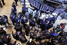 (AP Photo/Richard Drew) Traders gather at the post that handles Global Payments Inc. on the floor of the New York Stock Exchange, Monday in New York. Visa Inc. has dropped Global Payments, the card processor involved in a massive data breach, from its registry of providers that meet data security standards, but may reinstate it after a new compliance report.