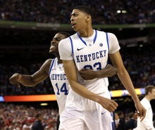 Kentucky forward Michael Kidd-Gilchrist (14) and forward Anthony Davis (23) celebrate during the second half of an NCAA Final Four semifinal college basketball tournament game Saturday, March 31, 2012, in New Orleans. Kentucky won 69-91. (AP Photo/David J. Phillip)