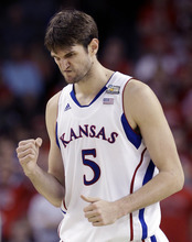Kansas center Jeff Withey (5) reacts during the second half of an NCAA Final Four semifinal college basketball tournament game against the Ohio State Saturday, March 31, 2012, in New Orleans.  Kansas won 64-62. (AP Photo/Charlie Neibergall)