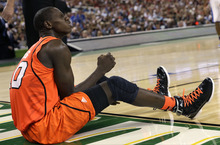 Louisville center Gorgui Dieng (10) reacts from the floor during the second half of an NCAA Final Four semifinal college basketball tournament game against Kentucky Saturday, March 31, 2012, in New Orleans. (AP Photo/David J. Phillip)