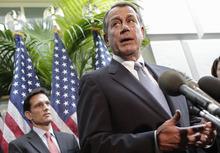 House Majority Leader Eric Cantor of Va. listens at left as House Speaker John Boehner of Ohio speaks during a news conference on Capitol Hill in Washington, Tuesday, Oct. 4, 2011. (AP Photo/J. Scott Applewhite)