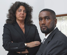 FILE - In this Oct. 11, 2011 file photo, Albert Florence, right, sits at his home Bordentown, N.J., with his attorney Susan Chana Lask. In a 5-4 decision, the Supreme Court ruled against Florence, who faced strip searches in two county jails following his arrest on a warrant for an unpaid fine that he had, in reality, paid. An ideologically divided court ruled Monday, April 2, 2012, that jailers may perform invasive strip searches on people arrested even for minor offenses. (AP Photo/Mel Evans, File)
