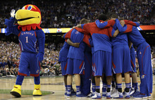 Kansas players join together before the start of their NCAA Final Four tournament college basketball championship game against Kentucky, Monday, April 2, 2012, in New Orleans. (AP Photo/Mark Humphrey)