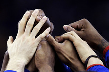 Kansas players join hands before their NCAA Final Four tournament college basketball championship game against Kentucky, Monday, April 2, 2012, in New Orleans. (AP Photo/Mark Humphrey) kansas