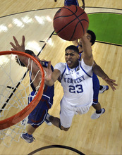 Kentucky forward Anthony Davis (23) drives ot the basket in front of Kansas center Jeff Withey, left, and forward Thomas Robinson, behind, during the second half of an NCAA Final Four college basketball tournament championship game Monday, April 2, 2012, in New Orleans. (AP Photo/Chris Steppig/NCAA Photos, Pool)