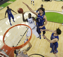 Kentucky's Michael Kidd-Gilchrist (14) drives to the basket past Kansas' Jeff Withey (5) during the second half of an NCAA Final Four college basketball tournament championship game Monday, April 2, 2012, in New Orleans. (AP Photo/Chris Steppig/NCAA Photos, Pool)