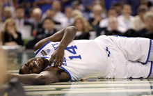 Kentucky forward Michael Kidd-Gilchrist (14) lies on the court after falling hard during the first half of the NCAA Final Four tournament college basketball championship game against Kansas Monday, April 2, 2012, in New Orleans. (AP Photo/Mark Humphrey)