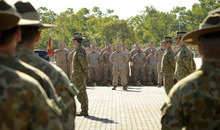 In this photo released by the Australian Department of Defense, U.S. Marine Corps personnel stand at attention with the 5th Battalion Royal Australian Regiment during an official welcome ceremony at Robertson Barracks, in Darwin,  Australia, Wednesday, April 4, 2012. The first detachment of 200 U.S. Marines has arrived in northern Australia, where a permanent joint training hub is taking shape as part of a U.S. shift of military strength in the Asia-Pacific region. (AP Photo/Australian Department of Defense,Chris Dickson)  NO SALES, EDITORIAL USE ONLY