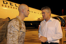 In this photo released by Australian Department of Defence, U.S. Marine Corps Company Commander Captain Christopher Richardella, left, of Fox Company, 2nd Battalion 3rd Marine Regiment, is greeted by Australia's Minister for Defence Stephen Smith upon arrival at RAAF Base Darwin in Darwin, Australia, late Tuesday night, April 3, 2012. Approximately 200 Marines of Fox Company, 2nd Battalion 3rd Marine Regiment, arrived at the base to begin the lead up to moving out field and commencing exercises in some of the Australian Defence Force's premier training areas in northern Australia. (AP Photo/CPL Chris Dickson) NO SALES, EDITORIAL USE ONLY