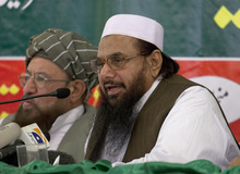 Hafiz Mohammad Saeed, right, chief of Jamaat-ud-Dawwa and founder of Lashkar-e-Taiba, addresses a news conference with anti-American cleric Sami ul Haq in Rawalpindi, Pakistan on Wednesday, April 4, 2012. Saeed, one of Pakistan's most notorious extremists mocked the United States during a defiant media conference close to the country's military headquarters, a day after the U.S. slapped a $10 million bounty on him. (AP Photo/B.K. Bangash)