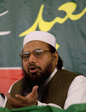 Hafiz Mohammad Saeed, chief of Jamaat-ud-Dawwa and founder of Lashkar-e-Taiba, addresses a news conference in Rawalpindi, Pakistan on Wednesday, April 4, 2012. Saeed, one of Pakistan's most notorious extremists, mocked the United States during a defiant media conference close to the country's military headquarters, a day after the U.S. slapped a $10 million bounty on him. (AP Photo/B.K. Bangash)