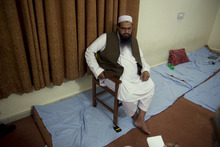 Hafiz Mohammad Saeed, chief of Jamaat-ud-Dawwa and founder of  Lashkar-e-Taiba listen to a reporter during his interview to the Associated Press in Islamabad, Pakistan on Tuesday, April 3, 2012. The United States has offered a $10 million bounty for a Pakistani militant leader who allegedly orchestrated the 2008 Mumbai attacks and has been directing an anti-American political movement in recent months. (AP Photo/B.K. Bangash)