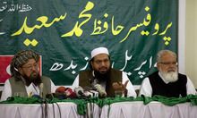 Hafiz Mohammad Saeed, center, chief of Jamaat-ud-Dawwa and founder of Lashkar-e-Taiba, addresses a news conference with anti-American cleric Sami ul Haq, left, and Liaquat Baluch in Rawalpindi, Pakistan on Wednesday, April 4, 2012. Saeed, one of Pakistan's most notorious extremists mocked the United States during a defiant media conference close to the country's military headquarters, a day after the U.S. slapped a $10 million bounty on him. Banner in background reads