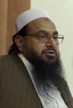 Hafiz Mohammad Saeed, chief of Jamaat-ud-Dawwa and founder of  Lashkar-e-Taiba talks with the Associated Press in Islamabad, Pakistan on Tuesday, April 3, 2012. The United States has offered a $10 million bounty for a Pakistani militant leader who allegedly orchestrated the 2008 Mumbai attacks and has been directing an anti-American political movement in recent months. (AP Photo/B.K. Bangash)