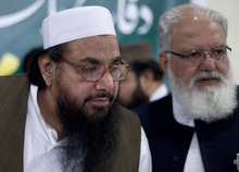 Hafiz Mohammad Saeed, left, chief of Jamaat-ud-Dawwa and founder of Lashkar-e-Taiba, listens to a reporter with Liaquat Baluch of Jamaat-e-Islami during his news conference in Rawalpindi, Pakistan on Wednesday, April 4, 2012. Saeed, one of Pakistan's most notorious extremists mocked the United States during a defiant media conference close to the country's military headquarters, a day after the U.S. slapped a $10 million bounty on him. (AP Photo/B.K. Bangash)