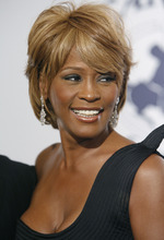 FILE - In this Oct. 28, 2006, file photo, musician Whitney Houston arrives at the 17th Carousel of Hope Ball benefiting the Barbara Davis Center for Childhood Diabetes in Beverly Hills, Calif. An autopsy report shows that cocaine was found in Houston's system and that investigators recovered whity powdery substances from her hotel room.  Houston died Feb. 11, in California at the age of 48. (AP Photo/Matt Sayles, file)
