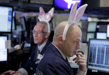 (AP Photo/Seth Wenig) Wednesday marked only the second time this year that the Dow has recorded a triple-digit decline. These traders were wearing bunny ears on the floor of the New York Stock Exchange in honor Annie's, a company whose mascot is a bunny and whose executives rang the opening bell.