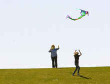 Paul Fraughton | The Salt Lake Tribune  Maggie Nickerson, left, and her daughter Rebecca launch their kite into the breezes blowing in Salt Lake's Sugarhouse Park on Wednesday, April 4, 2012.