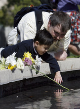 Francisco Kjolseth  |  The Salt Lake Tribune Drawn by water Brian Hoopes of Taylorsville stays close his son Patrick, 3, who is tethered to him for his intravenous fluids since he was essentially born without intestines. On Wednesday, April 4, 2012, Patrick ceremoniously started the Celebration of Life Monument fountain on Library Square in Salt Lake which is dedicated to those who have given the gift of life through organ, eye, tissue and blood donation. Patrick has been on the donor list for a small intestine for three years.