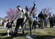 Francisco Kjolseth  |  The Salt Lake Tribune Brian Hoopes of Taylorsville holds on to his son Patrick, 3, who needs to stay within a tethered distance for his intravenous fluids since he was essentially born without intestines. On Wednesday, April 4, 2012, Patrick ceremoniously started the Celebration of Life Monument fountain on Library Square in Salt Lake which is dedicated to those who have given the gift of life through organ, eye, tissue and blood donation. Patrick has been on the donor list for a small intestine for three years.