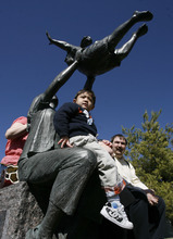 Francisco Kjolseth  |  The Salt Lake Tribune Patrick Hoopes, 3, of Taylorsville explores all the statues surrounding the Celebration of Life Monument at library square after he ceremoniously started started the fountain. The monument is dedicated to those who have given the gift of life through organ, eye, tissue and blood donation. Patrick has been on the donor list for a small intestine for three years. Patrick who was essentially born without intestines has been on the donor list for three years in hopes of getting a small intestine.