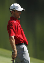 Mike Weir, of Canada, watches his putt on the 16th green during a practice round for the Masters golf tournament Monday, April 2, 2012, in Augusta, Ga. (AP Photo/Chris O'Meara)