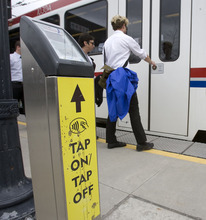 Al Hartmann   |  The Salt Lake Tribune  With the Tap On-Tap Off device at the Rice Eccles Stadium TRAX station,  University of Utah students can use identification cards or credit cards as payment instead of using tokens.
