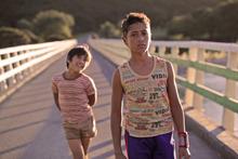 Brothers Rocky (Te Aho Aho Eketone-Whitu) and Boy (James Rolleston) walk home in