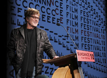 Sundance Institute president and founder Robert Redford addresses the audience before the opening night premiere of