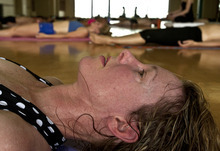 Leah Hogsten  |  The Salt Lake Tribune Rebecca Farnsworth of Sandy stays in the zone as the 90-minute class winds down. Students of Bikram Yoga in Sandy sweat through 26 postures and two breathing exercises in 90 minutes.