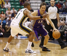 Phoenix Suns guard Steve Nash (13) drives past Utah Jazz guard Earl Watson (11) during the first half of an NBA basketball game on Wednesday, April 4, 2012, in Salt Lake City. (AP Photo/Jim Urquhart)