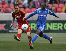 Steve Griffin/The Salt Lake Tribune   RSL's Will Johnson battles Montreal's Collen Warner for the ball during the RSL versus Montreal soccer game at Rio Tinto Stadium in Sandy Wednesday April 4, 2012.