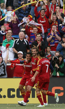 Steve Griffin/The Salt Lake Tribune   RSL's Paulo Junior, left, is mobbed by teammates Kyle Beckerman and Fabian Espindola after making penalty kick into the net during first half action in the RSL versus Montreal soccer game at Rio Tinto Stadium in Sandy Wednesday April 4, 2012.